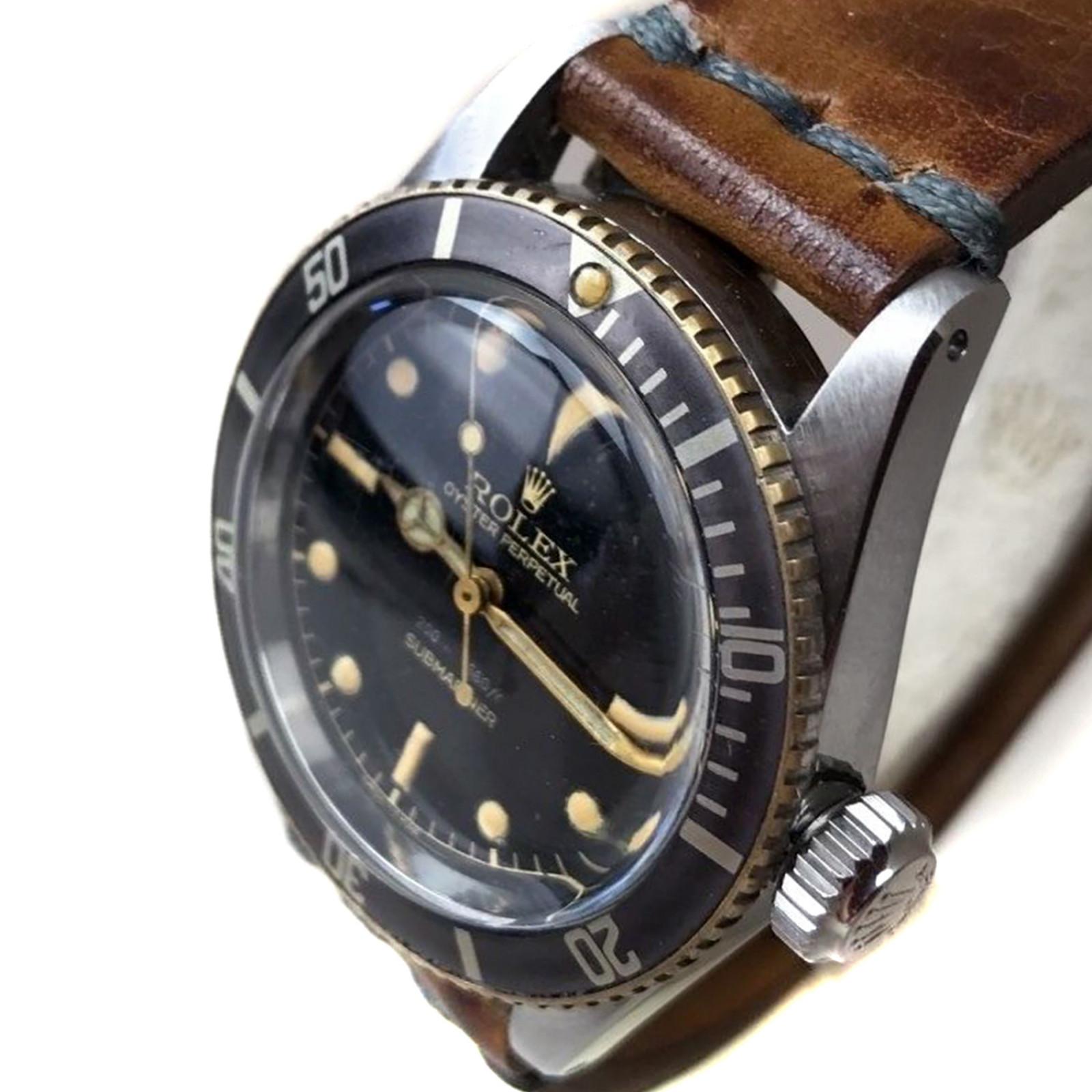 Vintage Rolex 6538 38 mm Steel on Strap, Black Bezel