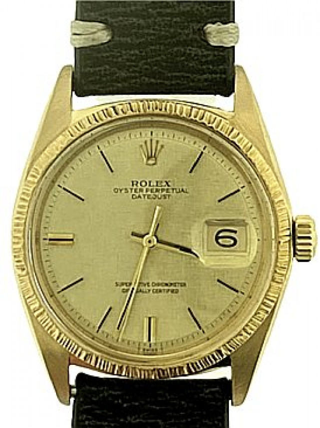 Rolex 1607 Steel on Strap, Finely Engine Turned Bezel Champagne with Gold Index