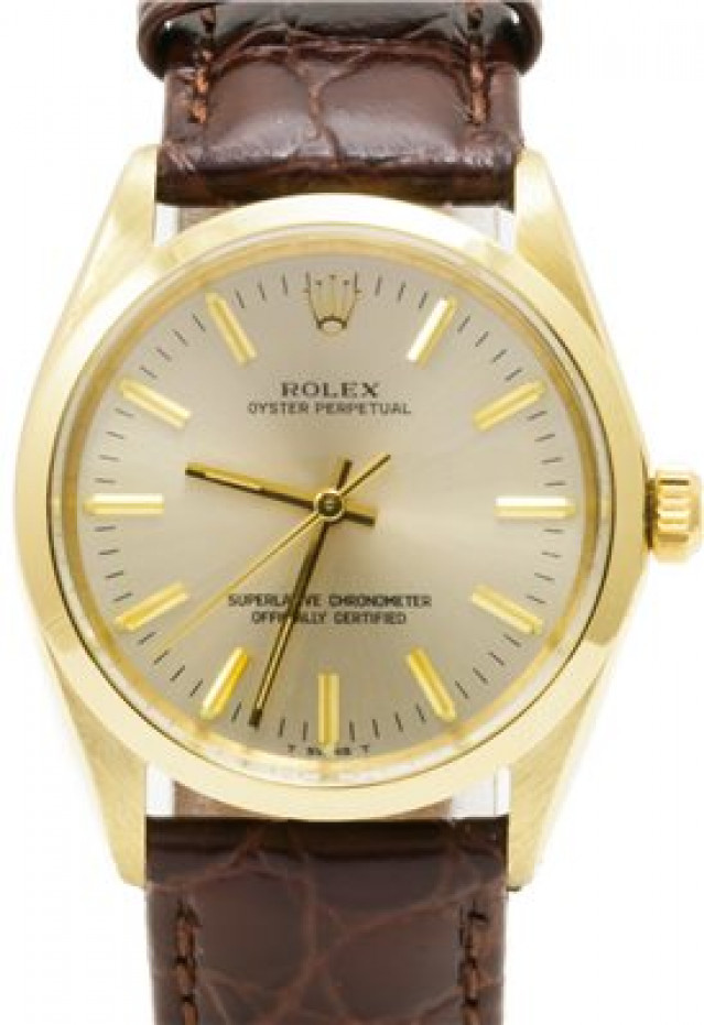Rolex 1002 Yellow Gold on Strap, Smooth Bezel Champagne with Gold Index