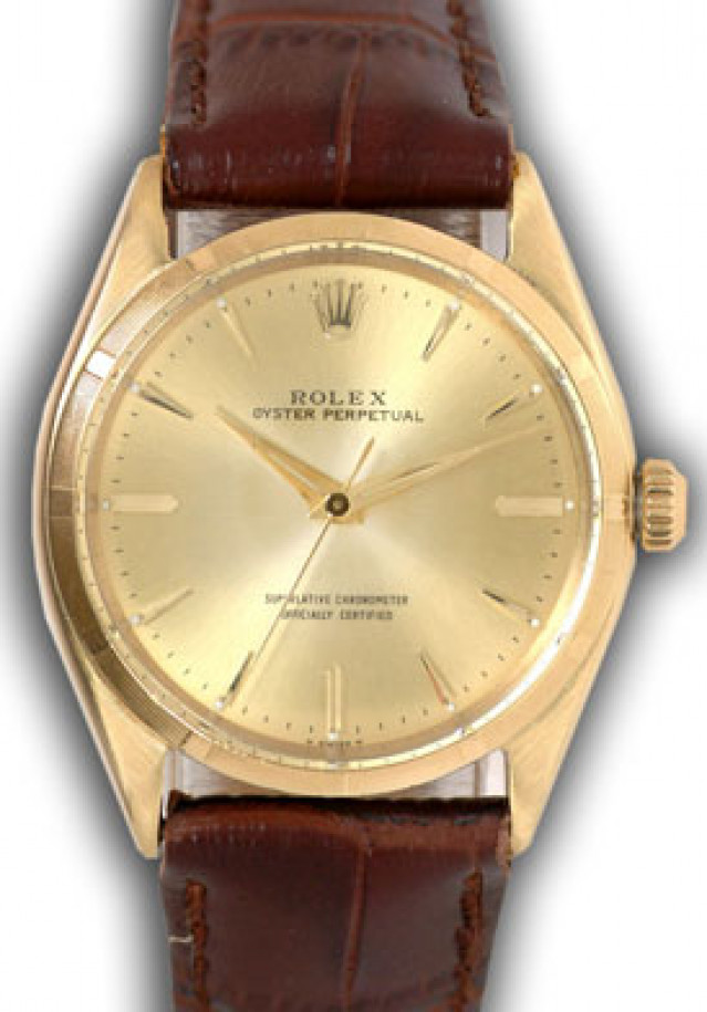 Rolex 1005 Yellow Gold on Strap, Engine Turned Bezel Champagne with Gold Index
